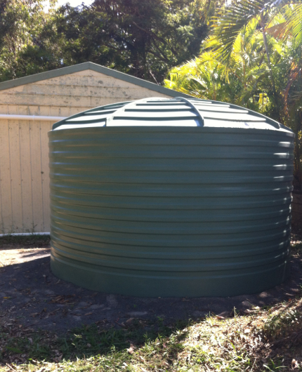 water tank installation next to shed